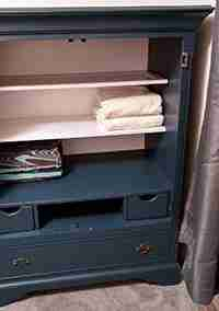 Armoire Repurposed into Linen Closet